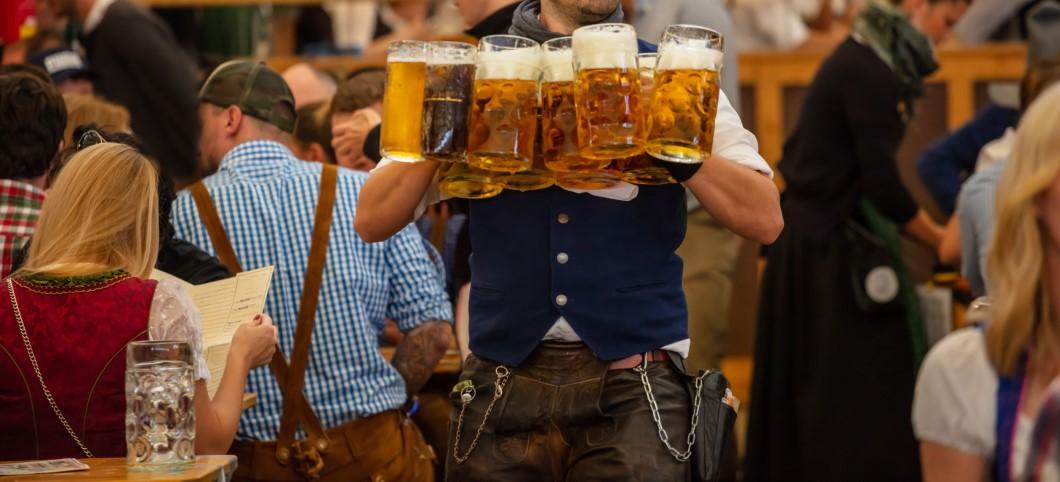 Waiter serving beers